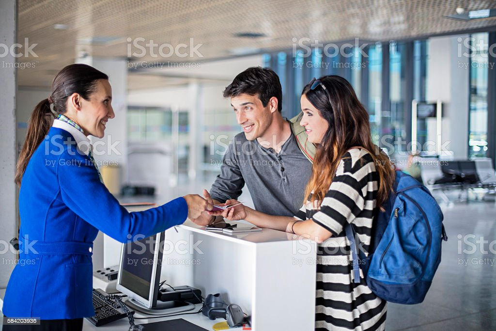 Young couple boarding to the plane at airport stock photo