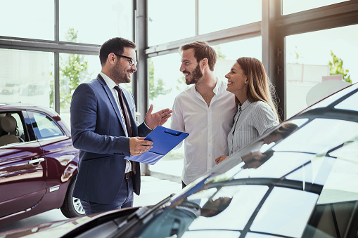 Young Couple Buying A Car Stock Photo - Download Image Now