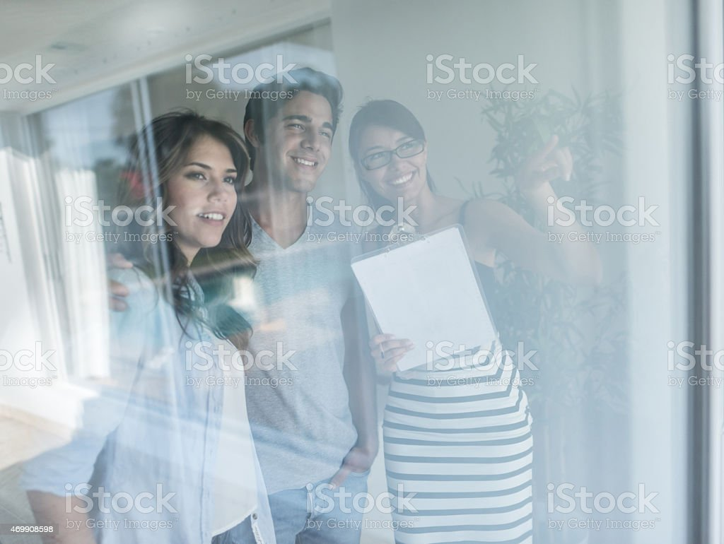Young couple buying a house stock photo