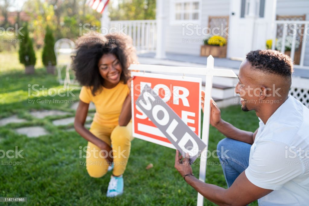 Young couple buying a new house Young couple buying a new house 25-29 Years Stock Photo