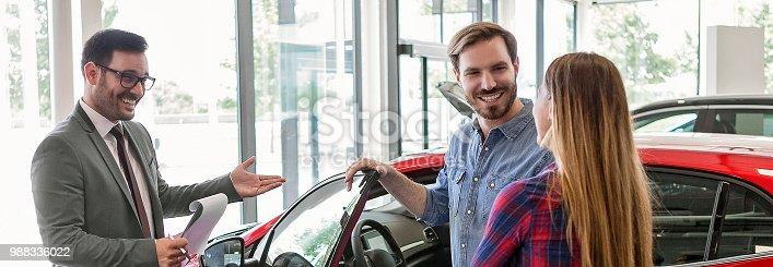 Car salesman making a sale