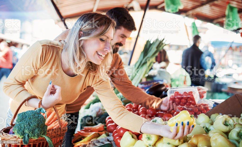 Young couple buying at street market. Lifestyle, consumerism, shopping stock photo