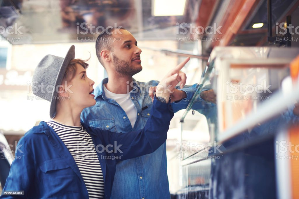Young couple buying food on the street stock photo
