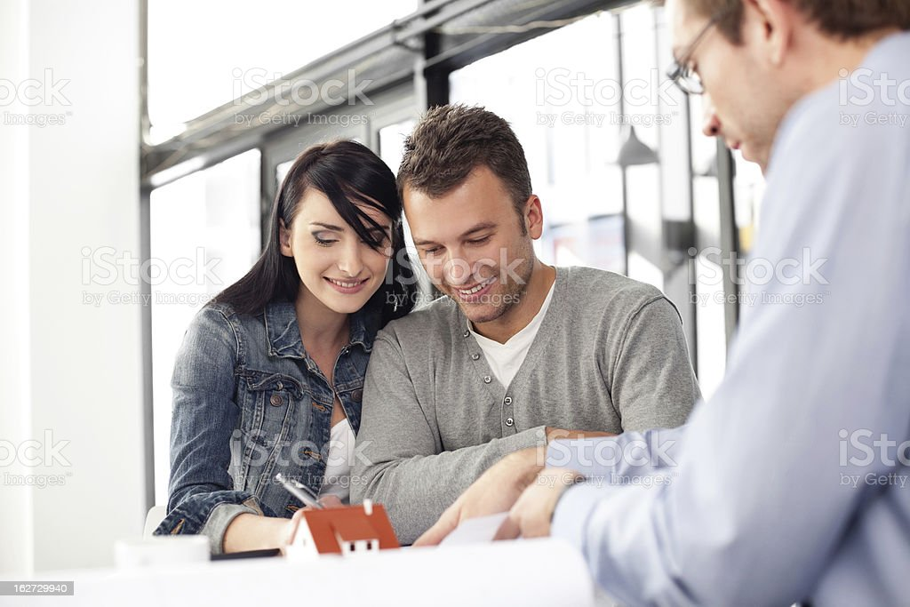 Young couple buying new home stock photo