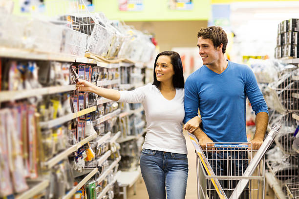 young couple buying padlock stock photo