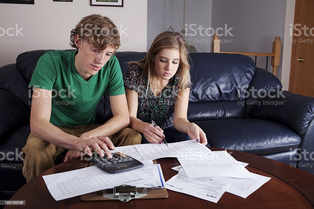 A young couple calculating their budget stock photo