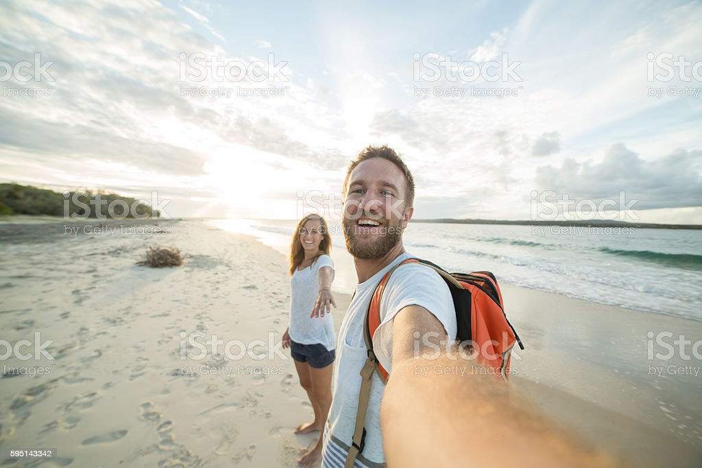 Young couple capturing summer vacation moments with selfie stock photo
