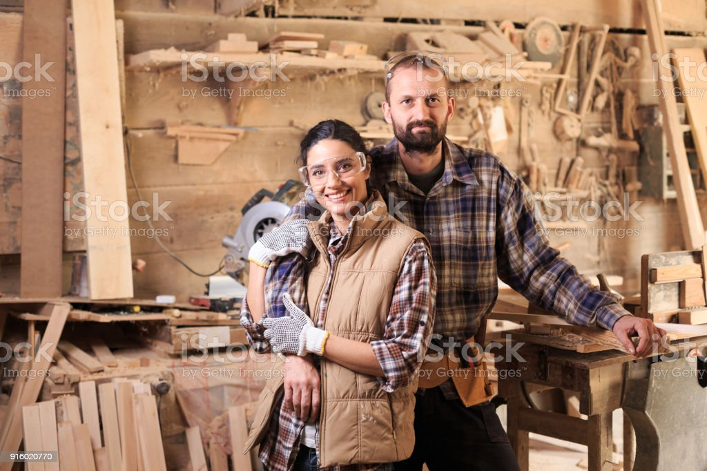 Young couple carpenter workers stock photo