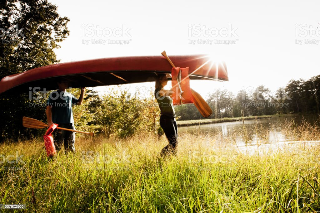 Young Couple Carry a Canoe stock photo