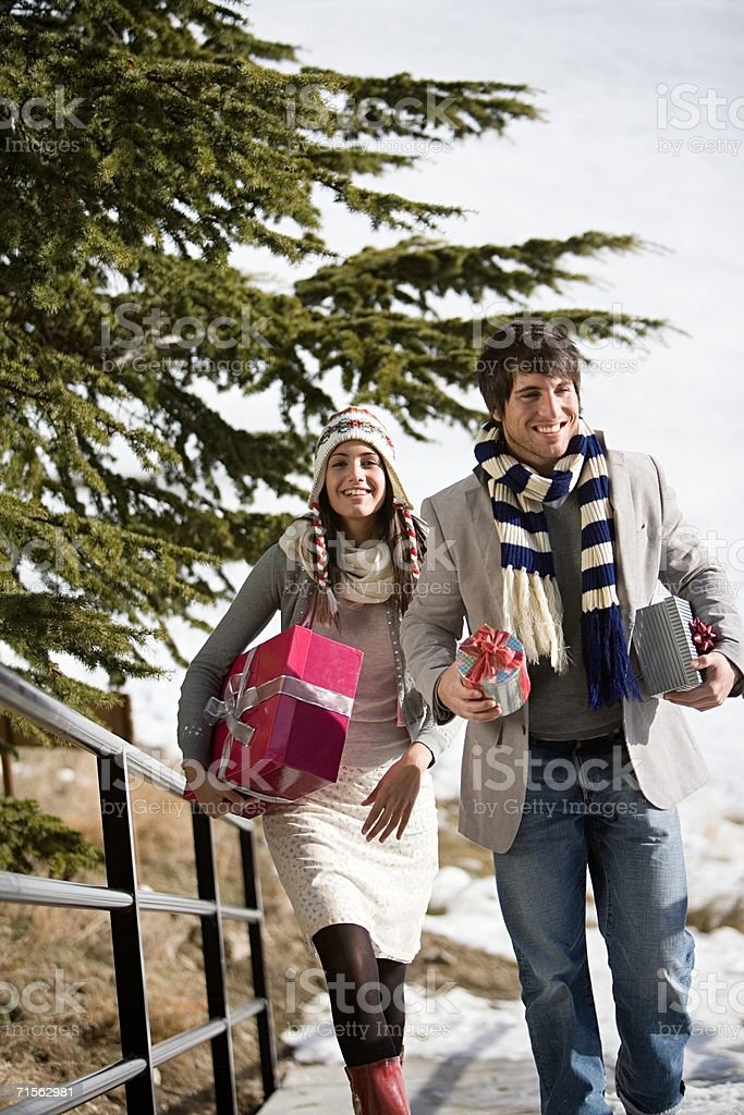 Young couple carrying gifts royalty-free stock photo