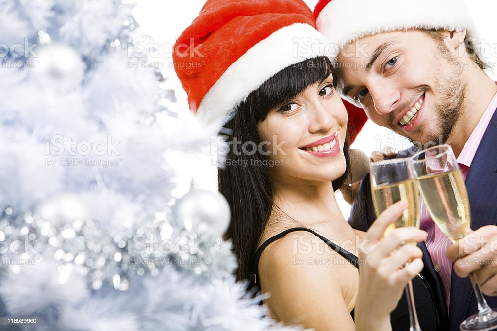 Young couple celebrating Christmas with champagne royalty-free stock photo