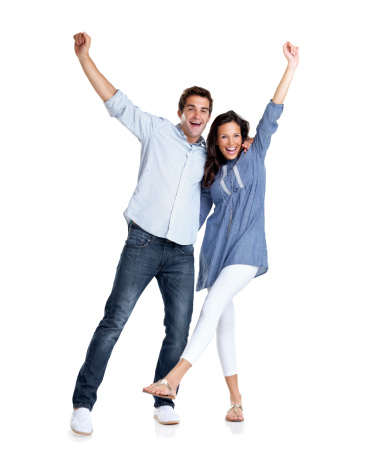 istock Young couple celebrating success with hands raised 121351489