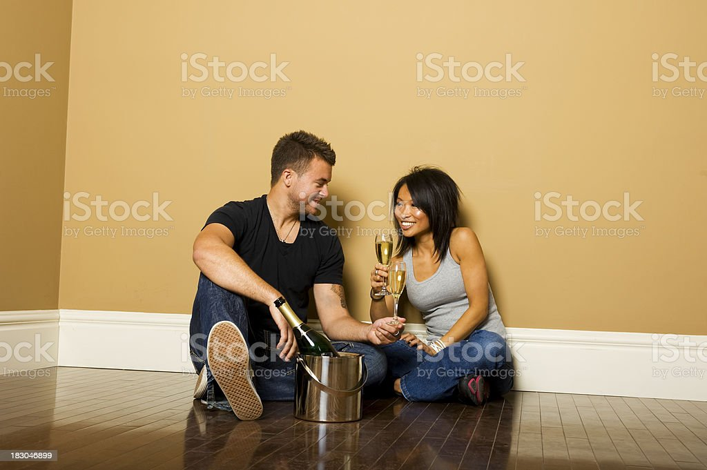 Young couple celebrating their house royalty-free stock photo