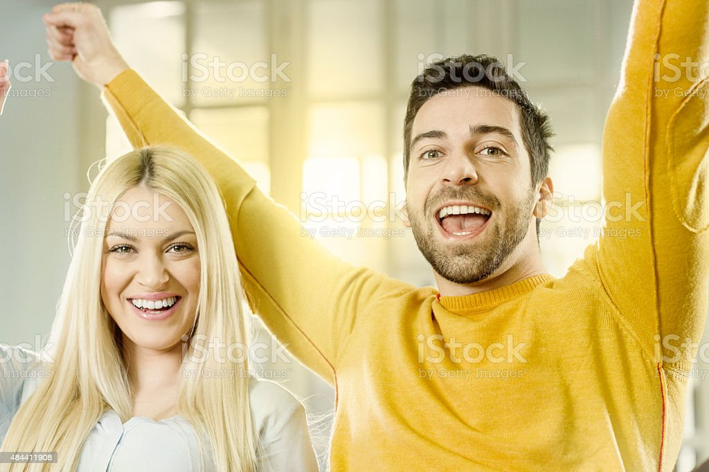 Young couple celebrating victory stock photo