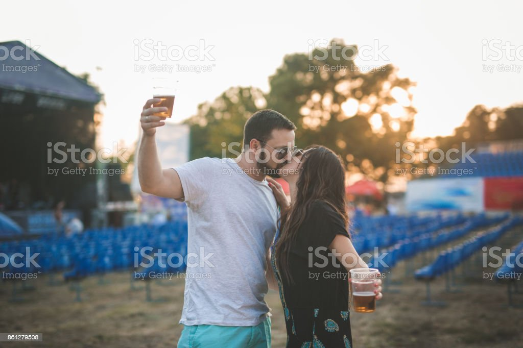 Young couple celebrating with music at festival royalty-free stock photo