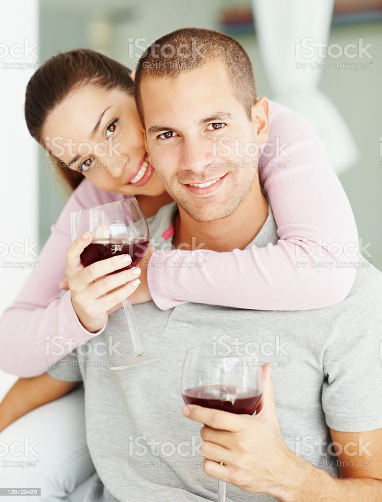 Young couple celebrating with wine royalty-free stock photo