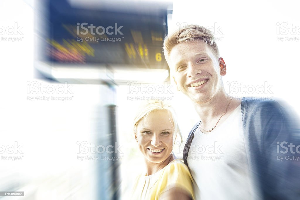 Young couple checking timetable royalty-free stock photo