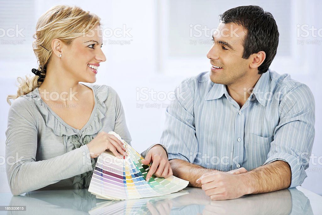 Young couple choosing color for wall royalty-free stock photo