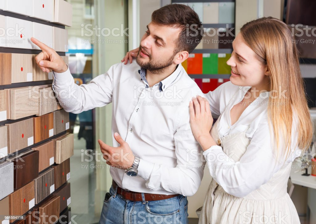 Young couple choosing furniture materials stock photo
