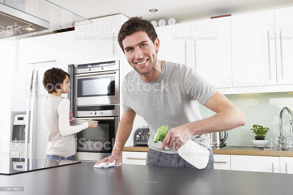 Young Couple Cleaning Kitchen royalty-free stock photo