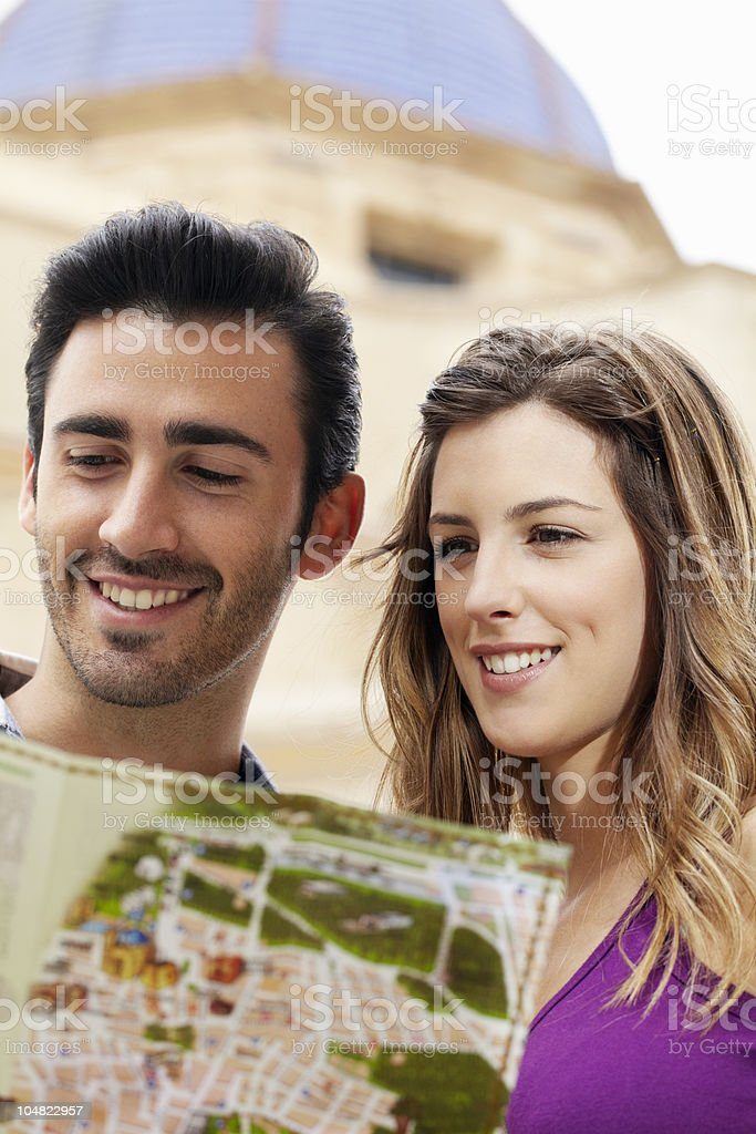 Young couple consulting map royalty-free stock photo