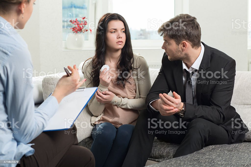 Young couple consults at the psychologist royalty-free stock photo