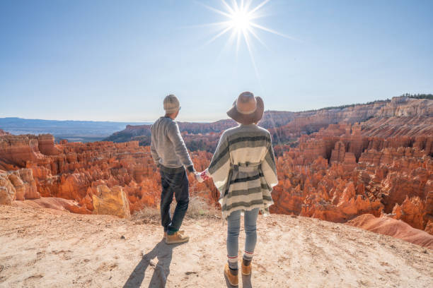 Young couple contemplating nature enjoying travel and adventure - America stock photo