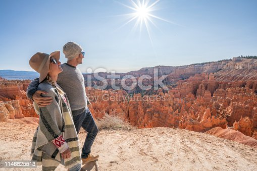 Young couple travel Bryce Canyon national park in Utah, United States, people travel explore nature. Couple hiking in red rock formations