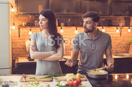 istock Young couple cooking in kitchen 838115010