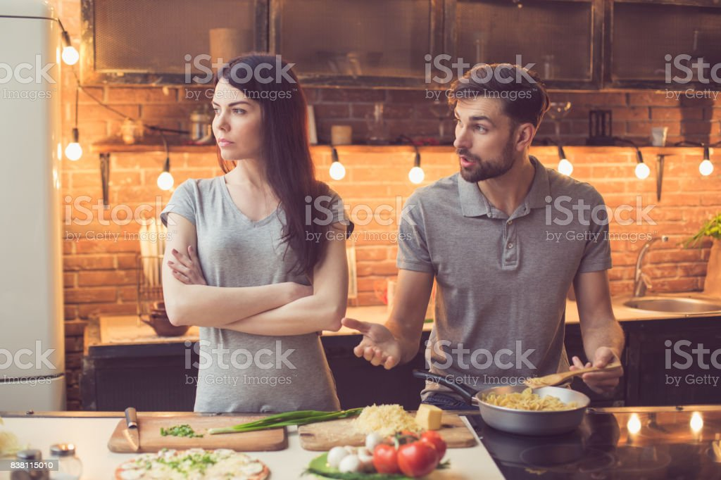 Young couple cooking in kitchen stock photo