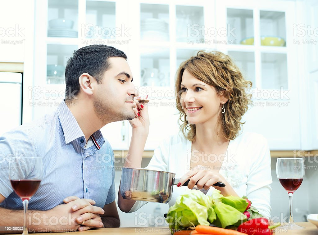 Young couple cooking royalty-free stock photo