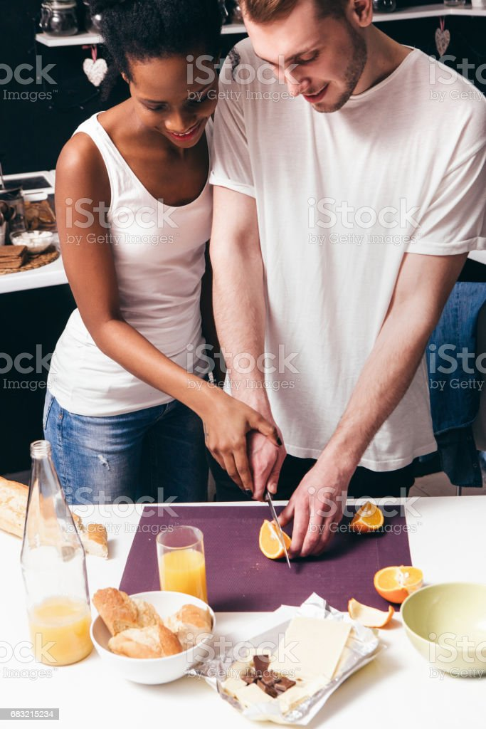 Young couple cooking together, culinary at home Lizenzfreies stock-foto