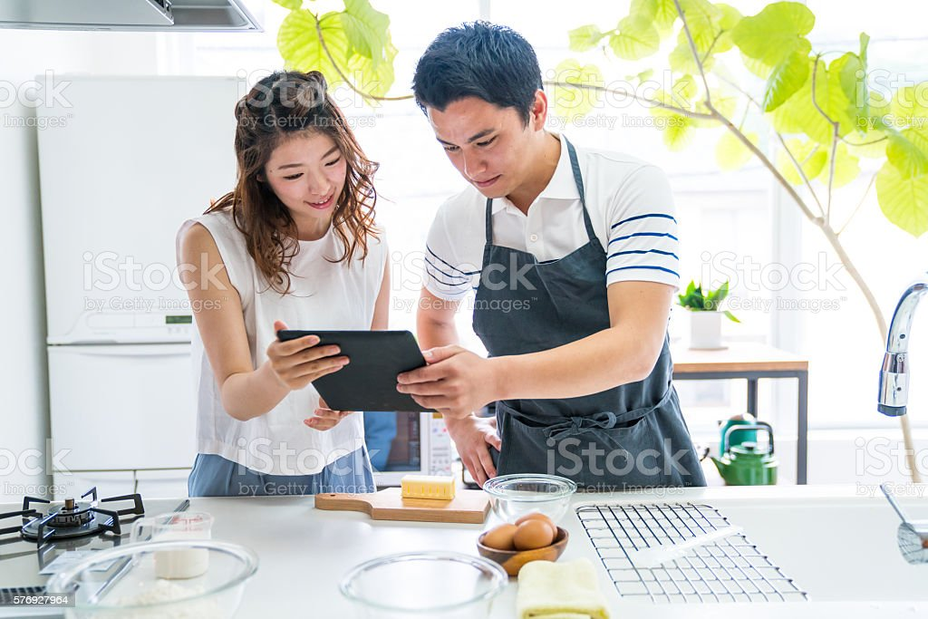 Young couple cooking together in a modern kitchen stock photo