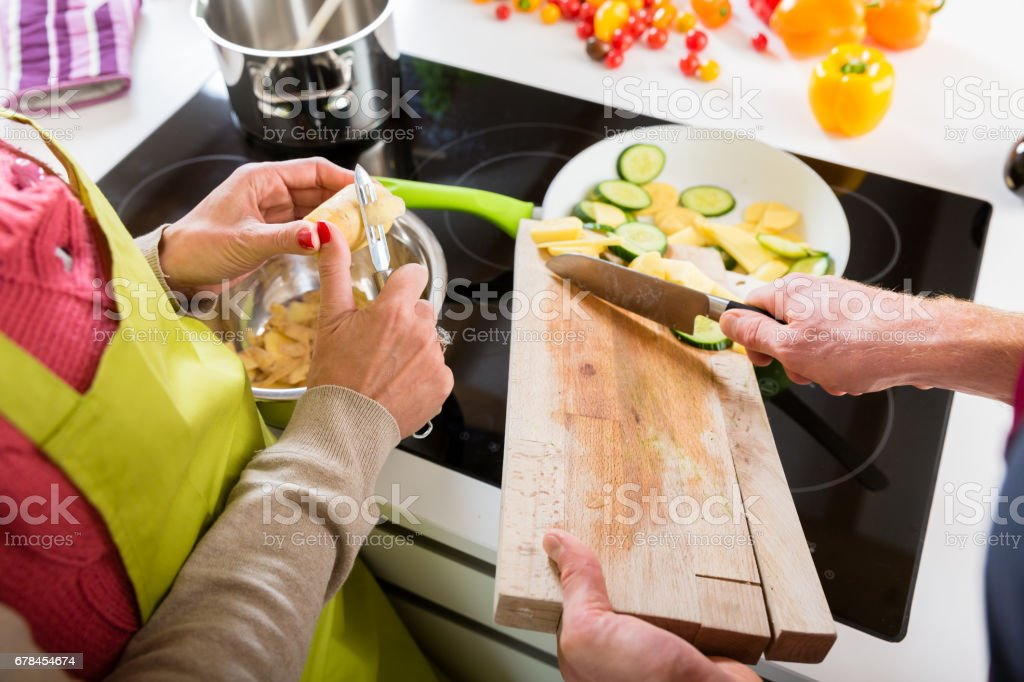 Young couple cooking together in kitchen royalty-free stock photo