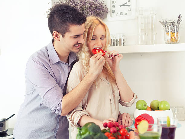 Young couple cooking together stock photo