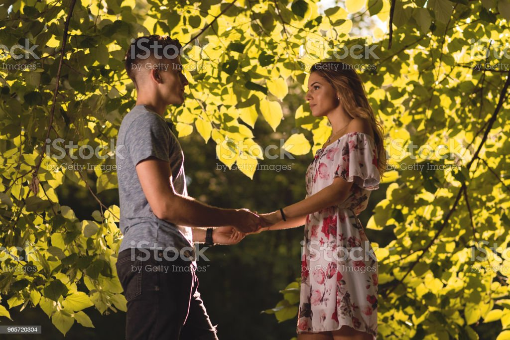 Young couple couple standing among greenery in nature - Royalty-free Adult Stock Photo