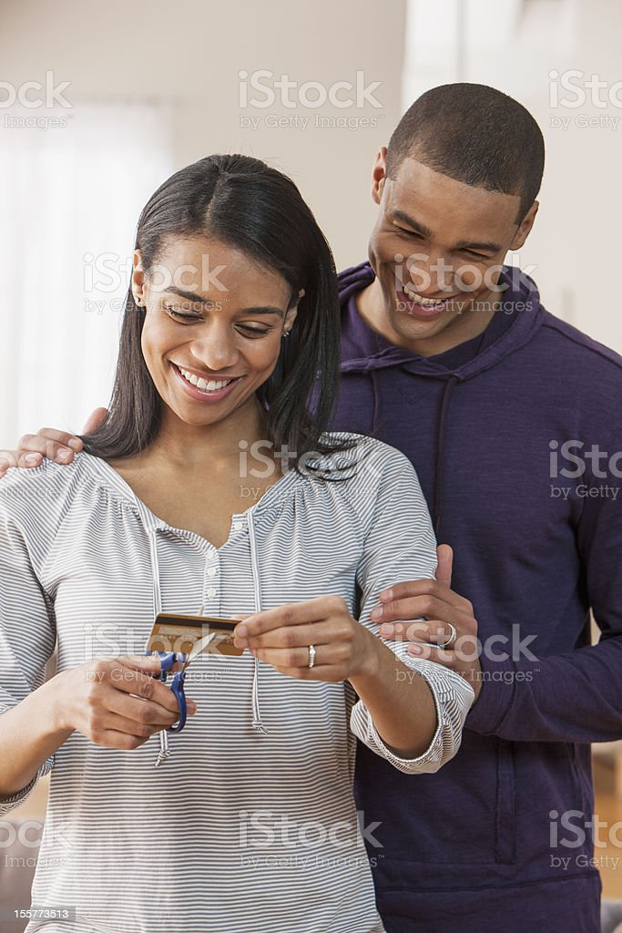 Young couple cutting credit card royalty-free stock photo
