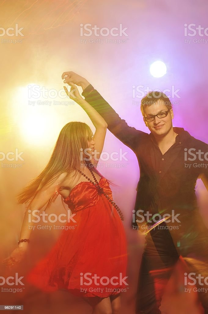Young couple dancing in the night club royalty-free stock photo