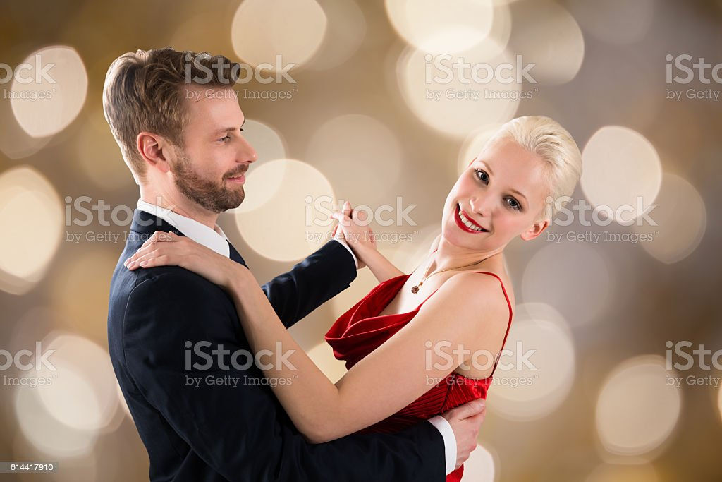 Young Couple Dancing On Bokeh Background stock photo