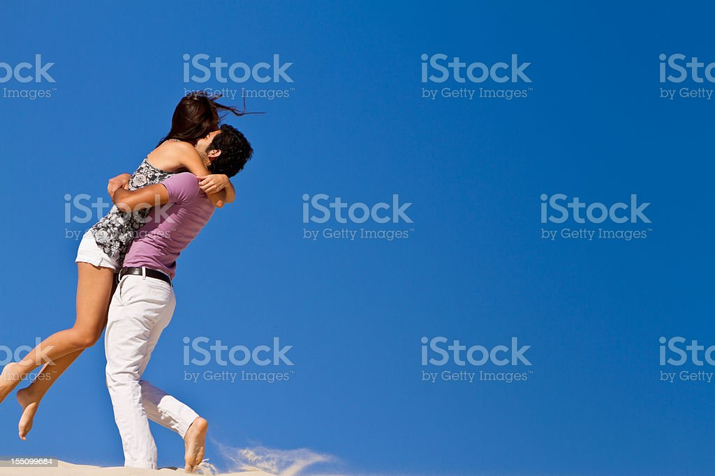 Young  Couple Dancing on Sand royalty-free stock photo