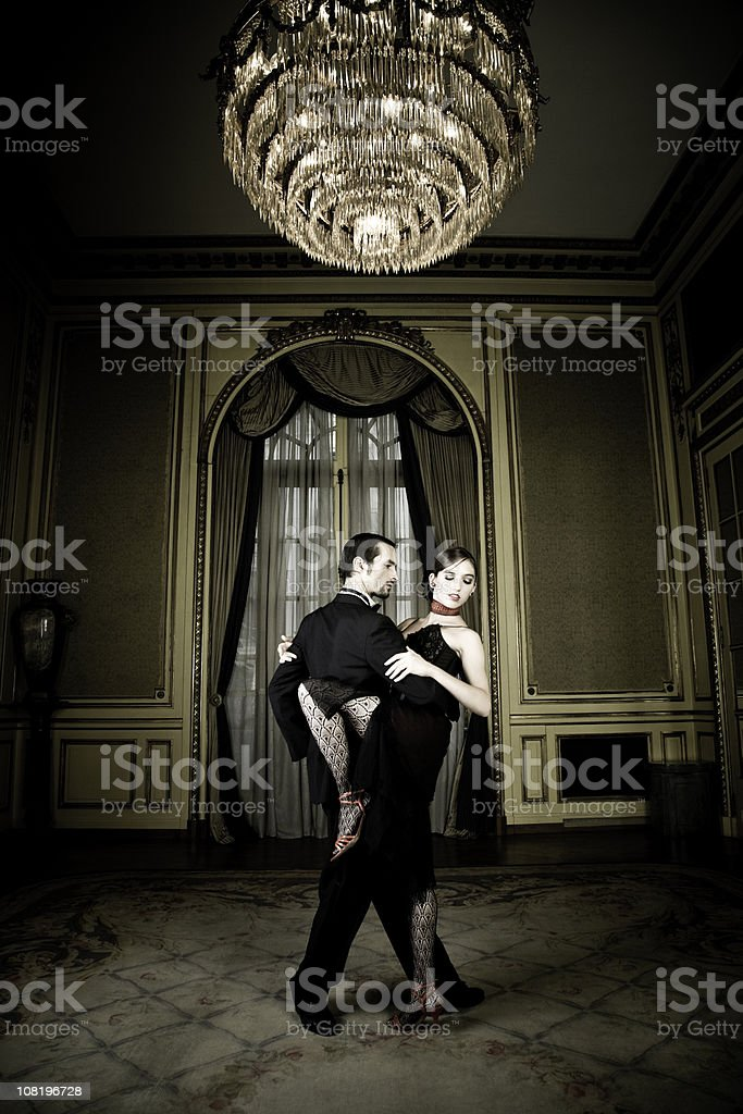 Young Couple Dancing Tango in Elegant Room royalty-free stock photo