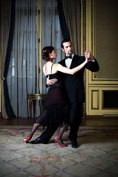Young Couple Dancing Tango in Elegant Room stock photo