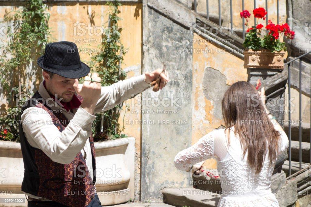 Young Couple Dancing Tarantella in Naples, Italy stock photo