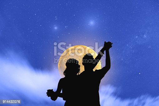 Young couple dancing under the moonlight and stars. My astronomy work.