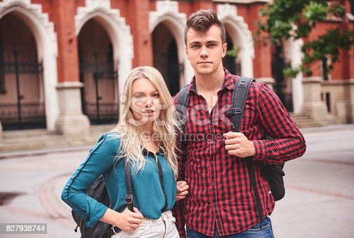 istock Young couple dating in college 827938744