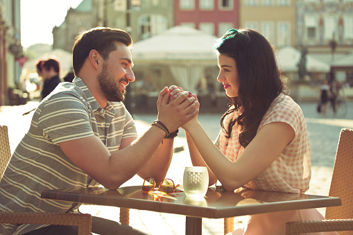 Young Couple Dating In The Outdoor Restaurant Stock Photo - Download Image Now