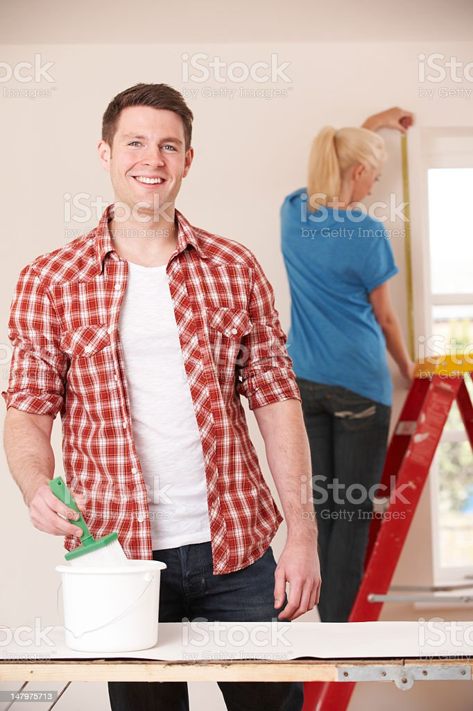 Young Couple Decorating New Home Together royalty-free stock photo