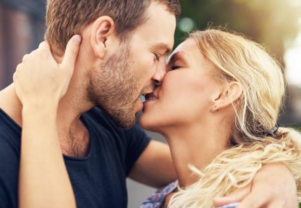 young couple deeply in love - zoen stockfoto's en -beelden