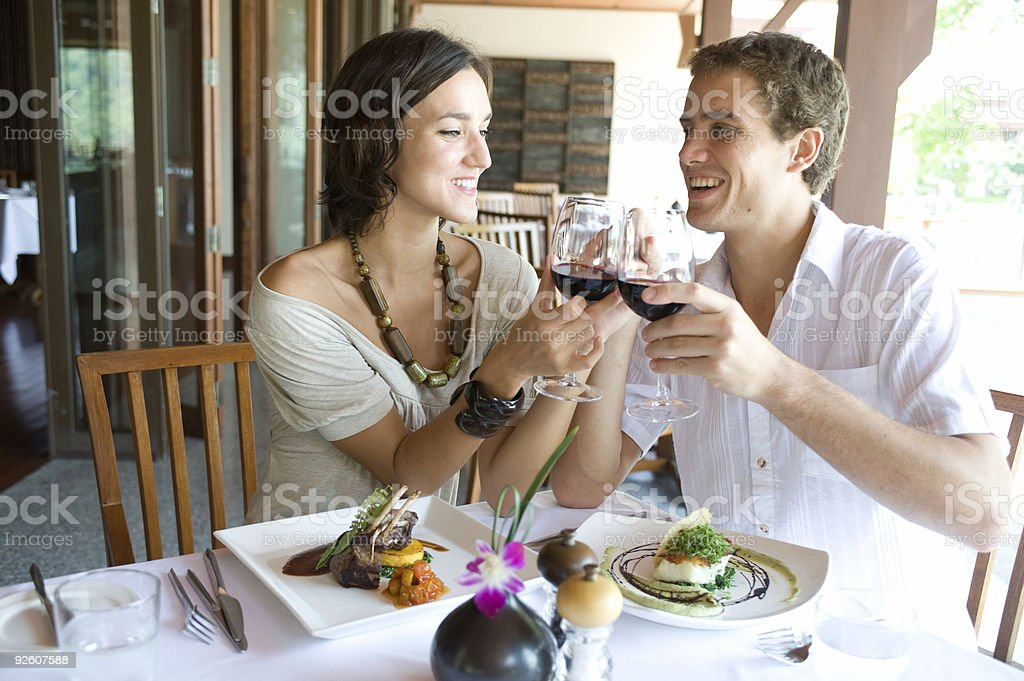 Young couple dining and drinking wine royalty-free stock photo