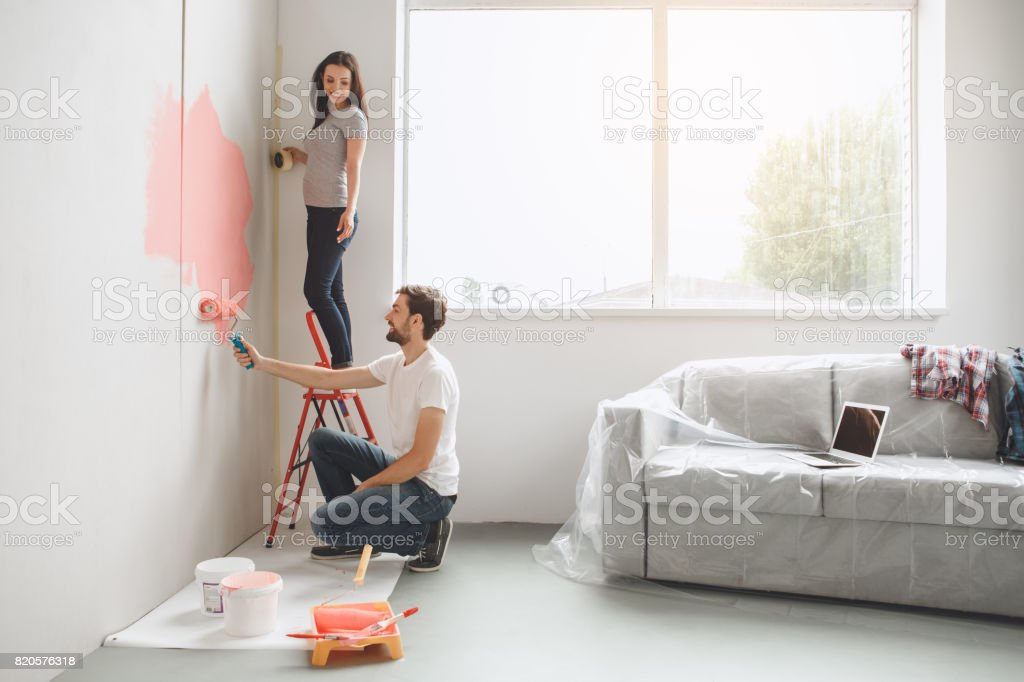 Young couple doing apartment repair together themselves